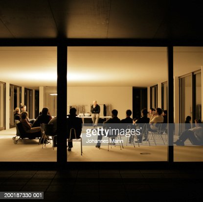 Group of people in meeting, view through window
