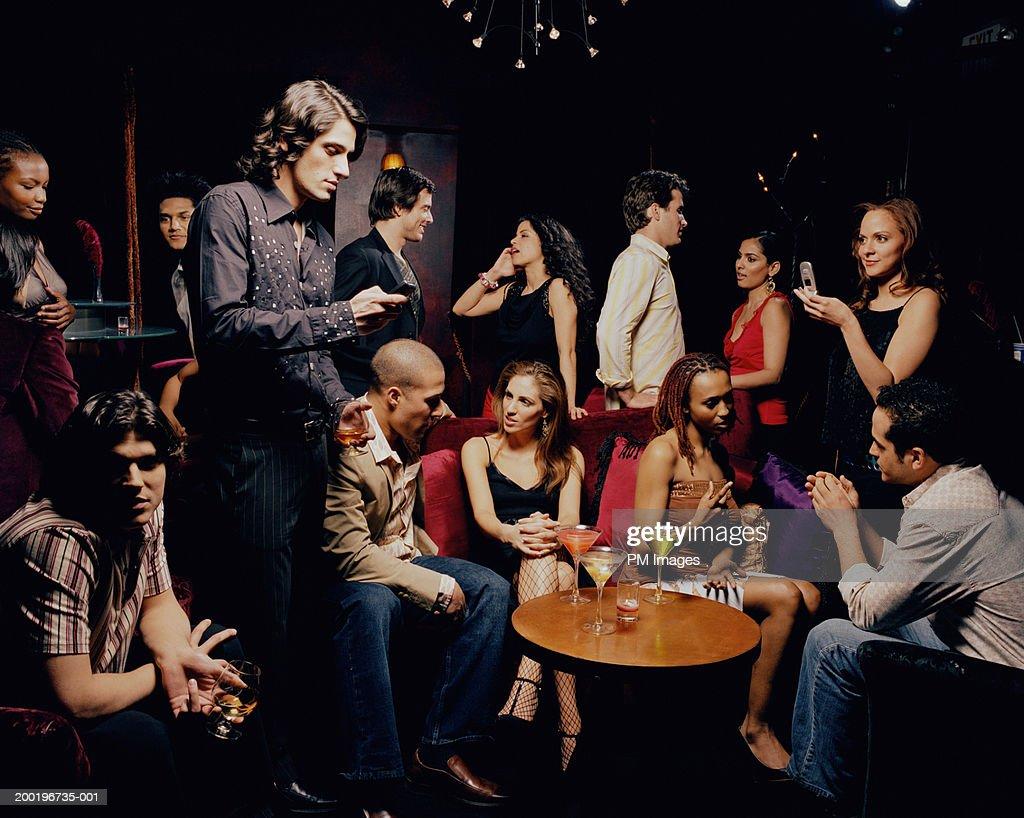 Group of people in nightclub : Stock Photo