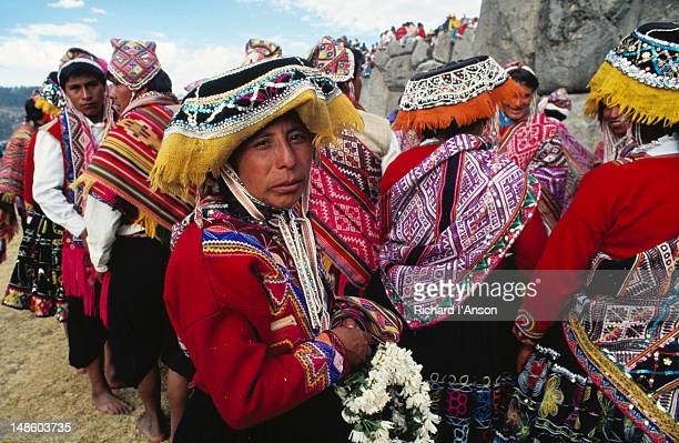 A group of people in traditional costumes, part of the Inti Raymi procession, a spectacle staged for tourists once a year at the site of Incan ruins at Sacsaywaman.