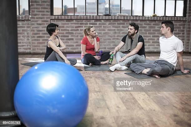 Group of people in yoga class studio