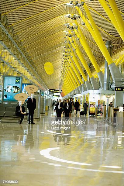 Group of people inside a terminal, Madrid, Spain
