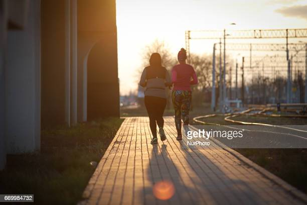 A group of people is seen taking part in a monthly organized track running event at the newly built Bydgoszcz Wschod train station on 18 April 2017