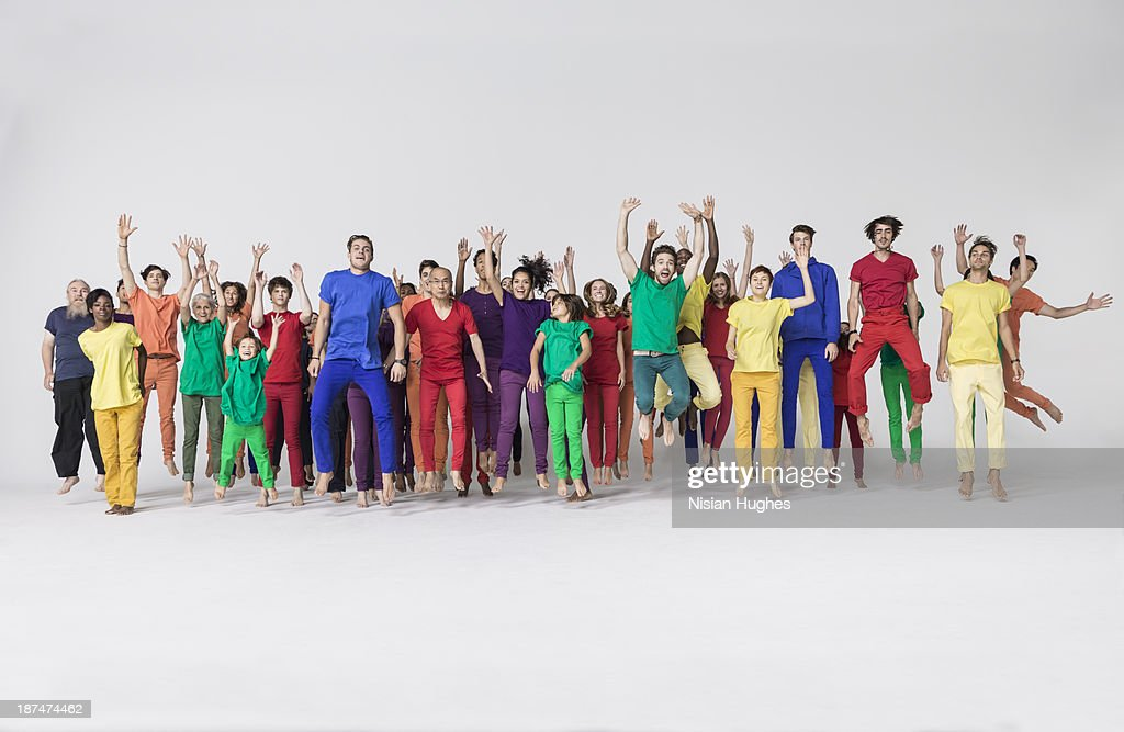 Group of people jumping happily : Stock Photo