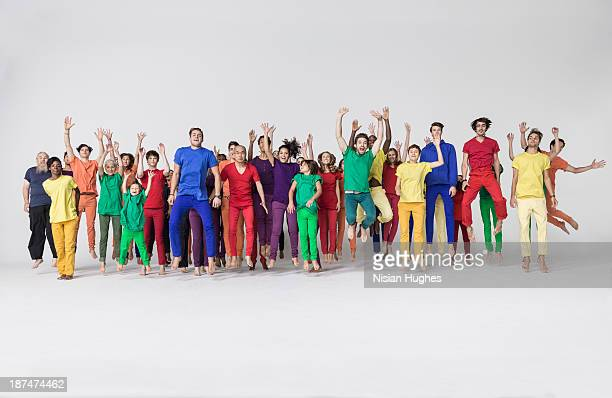 Group of people jumping happily