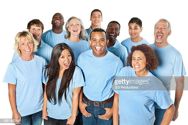 Group of people laughing together, all in blue shirts