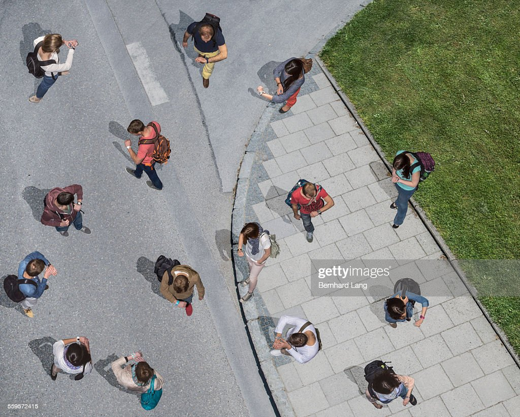 Group of people looking on watches, Aerial Views : Stock Photo