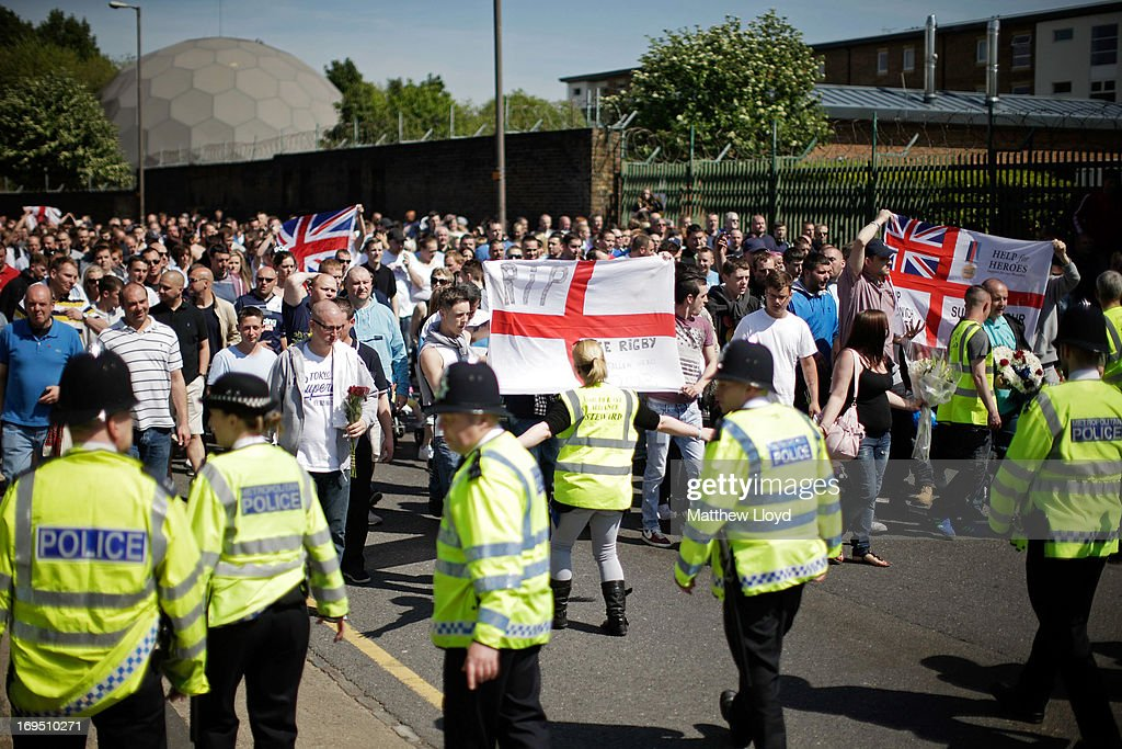A group of people march from the scene where Drummer Lee Rigby of the 2nd Battalion the Royal Regiment of Fusiliers was killed, to the Royal Artillery Barracks in a show of support on May 26, 2013 in London, England. Drummer Lee Rigby of the 2nd Battalion the Royal Regiment of Fusiliers was murdered by suspected Islamists near London's Woolwich Army Barracks. His family visited the scene of his murder today and left floral tributes whilst it was confirmed by the Foreign Office that one of the suspects, Michael Adebolajo, was arrested in Kenya in 2010.