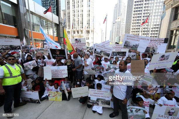 Group of people mostly Rohingya Muslims living in US hold banners and shout slogans as they stage a demonstration at Michigan Avenue to protest the...