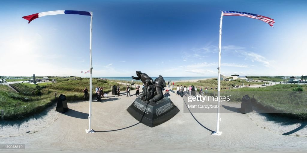 A group of people move around the World War II memorial at Utah Beach on June 7, 2014 in Normandy, France. Yesterday was the 70th anniversary of the D-Day landings, which saw 156,000 troops from the allied countries including the United Kingdom and the United States join forces to launch an audacious attack on the beaches of Normandy, these assaults are credited with the eventual defeat of Nazi Germany.