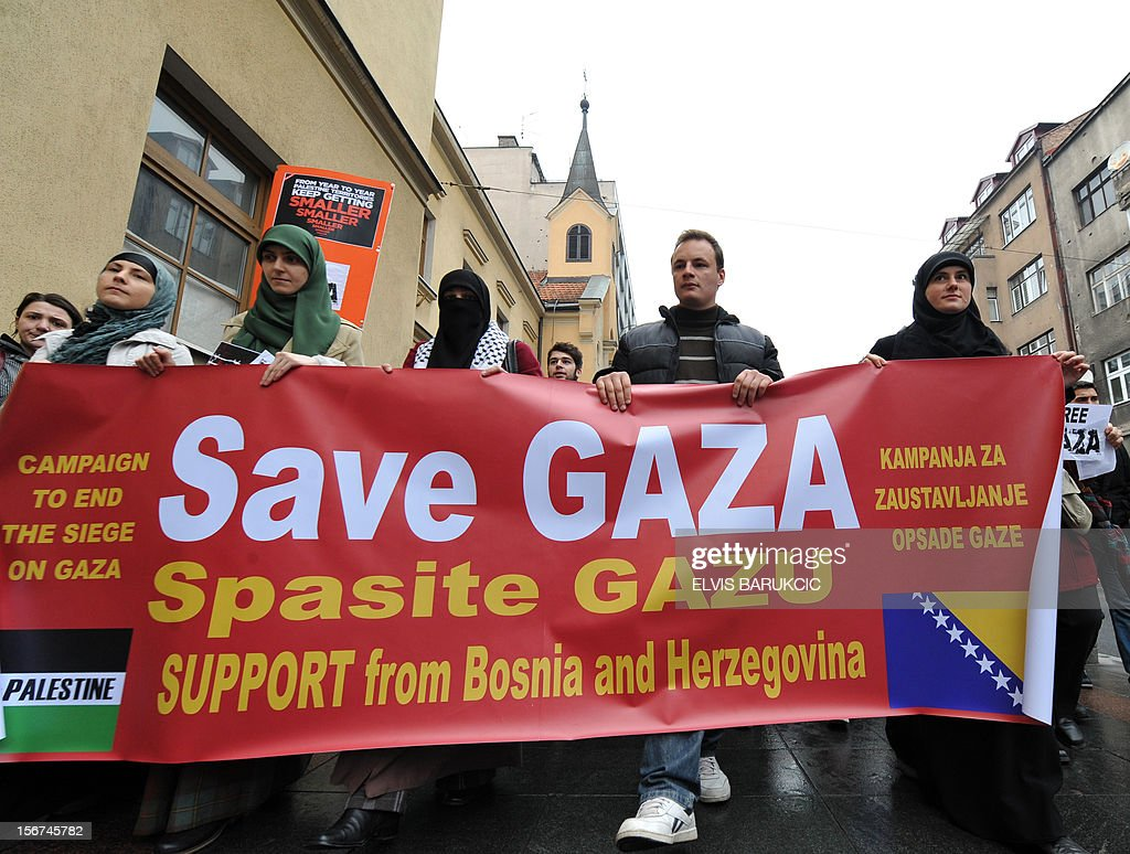 A group of people of Palestinian origin, backed by several hundred citizens of Sarajevo, walk on November 20, 2012 through the city center, in support of the Palestinian people after the latest Israeli attacks in Gaza. A larger protest has been anounced for November 23. AFP PHOTO / ELVIS BARUKCIC