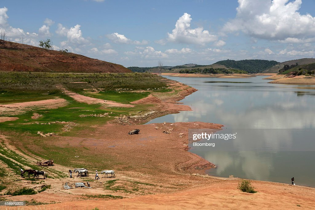 A group of people on a church pilgrimage walk with their horses at the Jaguari Reservoir near Sao Jose dos Campos in the state of Sao Paulo Brazil on...