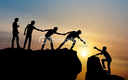 Group of people on peak mountain climbing helping team work , travel trekking success business concept : Stock Photo