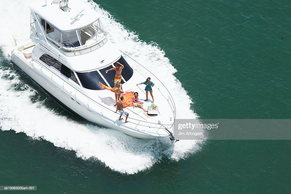 Group of people on speedboat at sea, aerial view