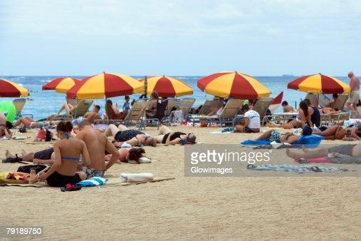 Group of people on the beach, Waikiki Beach, Honolulu, Oahu, Hawaii Islands, USA : Stock Photo