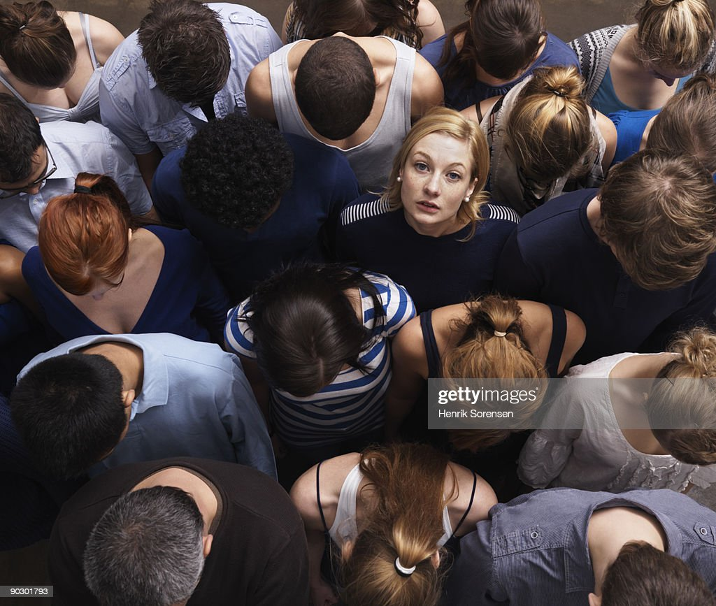 group of people, one looking up : Stock Photo