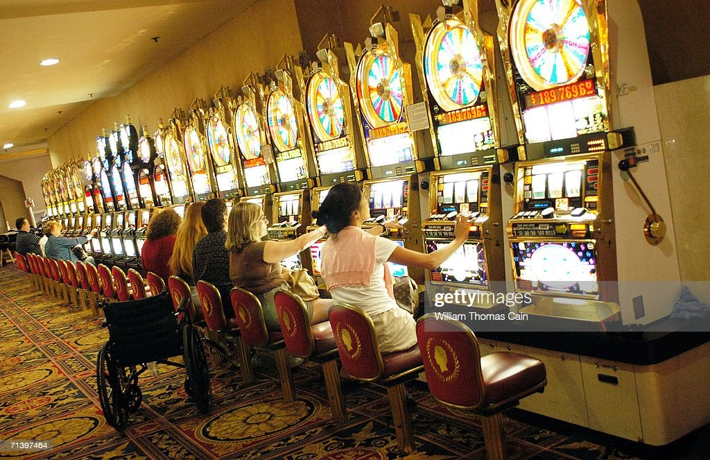 A group of people play slot machines at Caesars Atlantic City July 8, 2006 in Atlantic City, New Jersey. Caesars, along with Atlantic City's 11 other casinos reopend this morning after they were forced to close their gambling floors for the first time in their 28-year history due to the New Jersey state budget impasse.