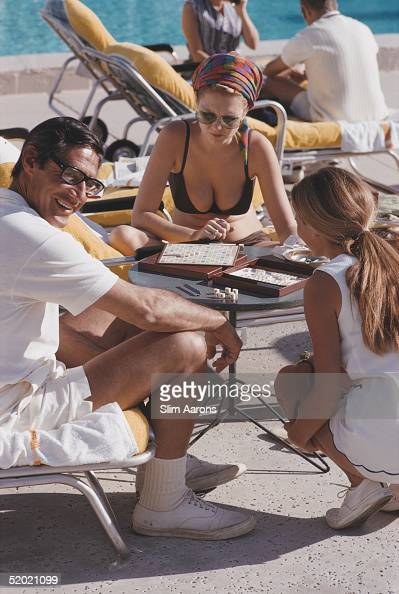 A group of people playing a game of Scrabble Palm Springs southern California January 1970