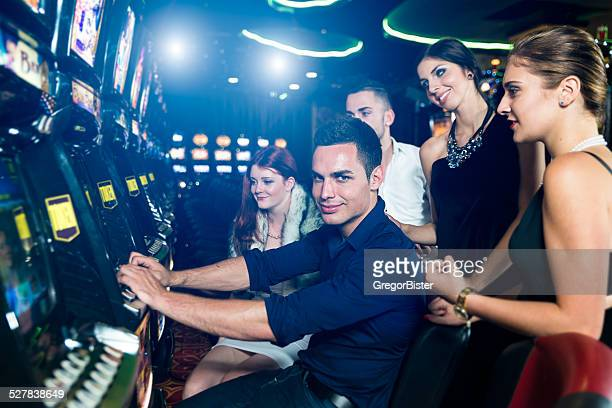 Group of people playing slot machines