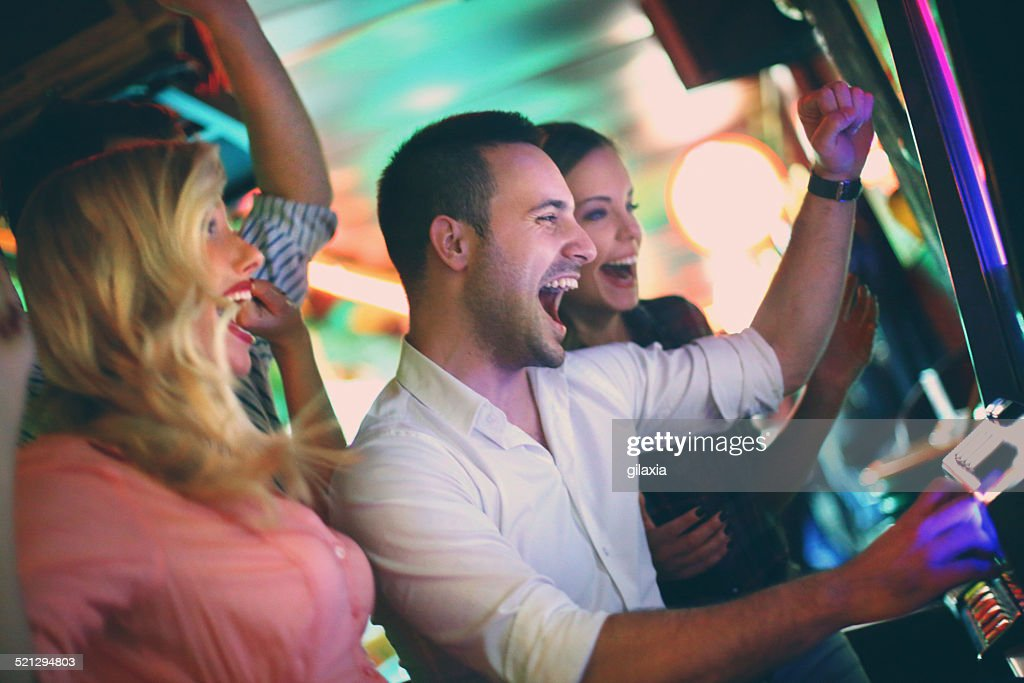 Group of people playing slots. : Stock Photo