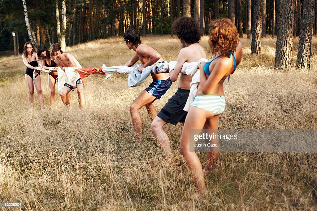 Group of people playing tug of war with towels : Stock Photo