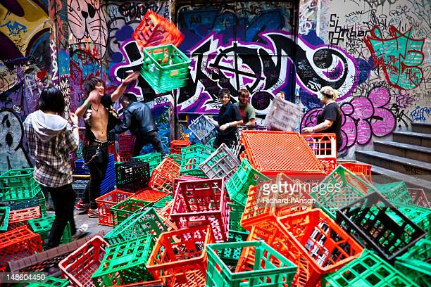Group of people playing with milk crates in Degraves Lane.