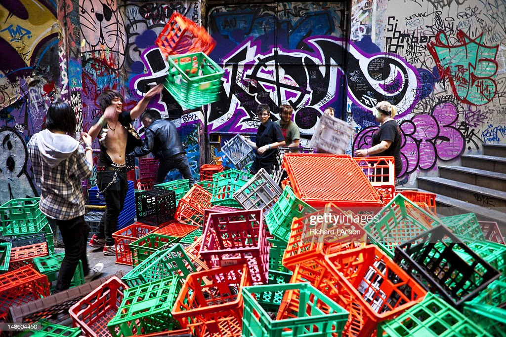 group of people playing with milk crates in degraves lane