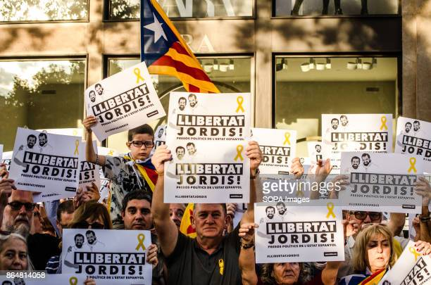 A group of people show posters in defense of detainees About 450000 people have been focused to support the Government and the Catalan institutions...