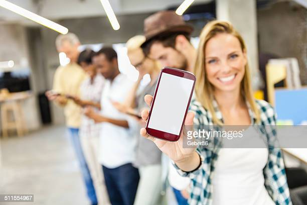 Group of people showing their smart phones