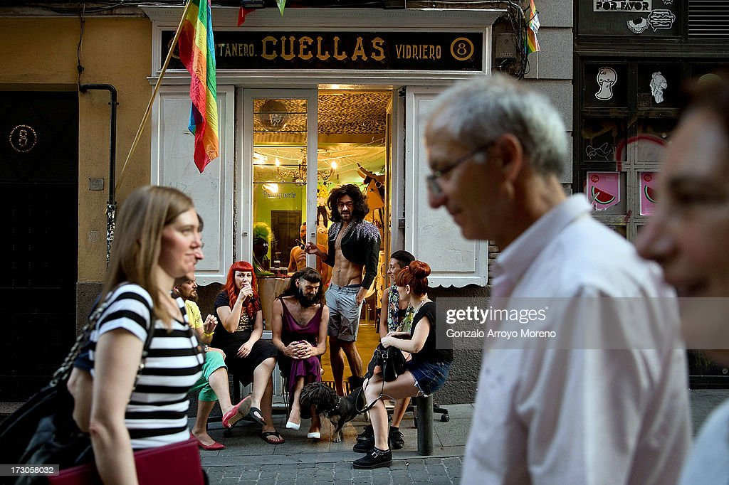 A group of people sit in front of a hairdresser in the Chueca neighborhood during the Madrid Gay Pride Festival 2013 on July 5, 2013 in Madrid, Spain. According to a new Pew Research Center survey about homosexual acceptance around the world, Spain tops gay-friendly countries with an 88 percent acceptance rate.