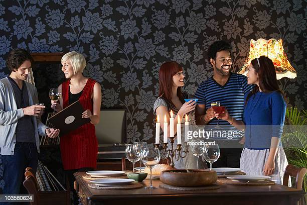 Group of people smiling,  standing by dining table