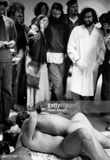 A group of people smoke pot and watch as a couple have sex during the last day of The Alternative Media Conference on June 20 1970 at Goddard College...