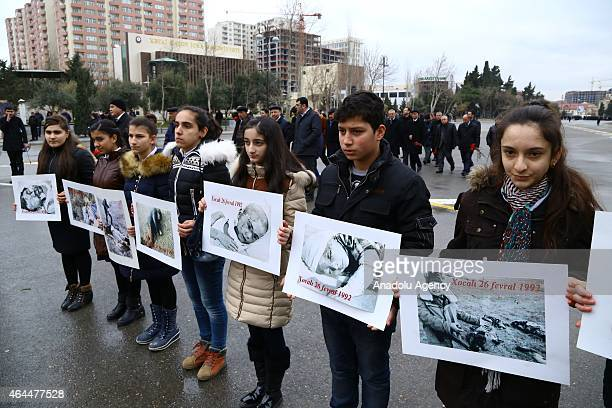 A group of people stage protest in front of 'Khojaly Genocide Memorial' also known as 'Mother's Cry Monument' during the commemoration of Khojaly...