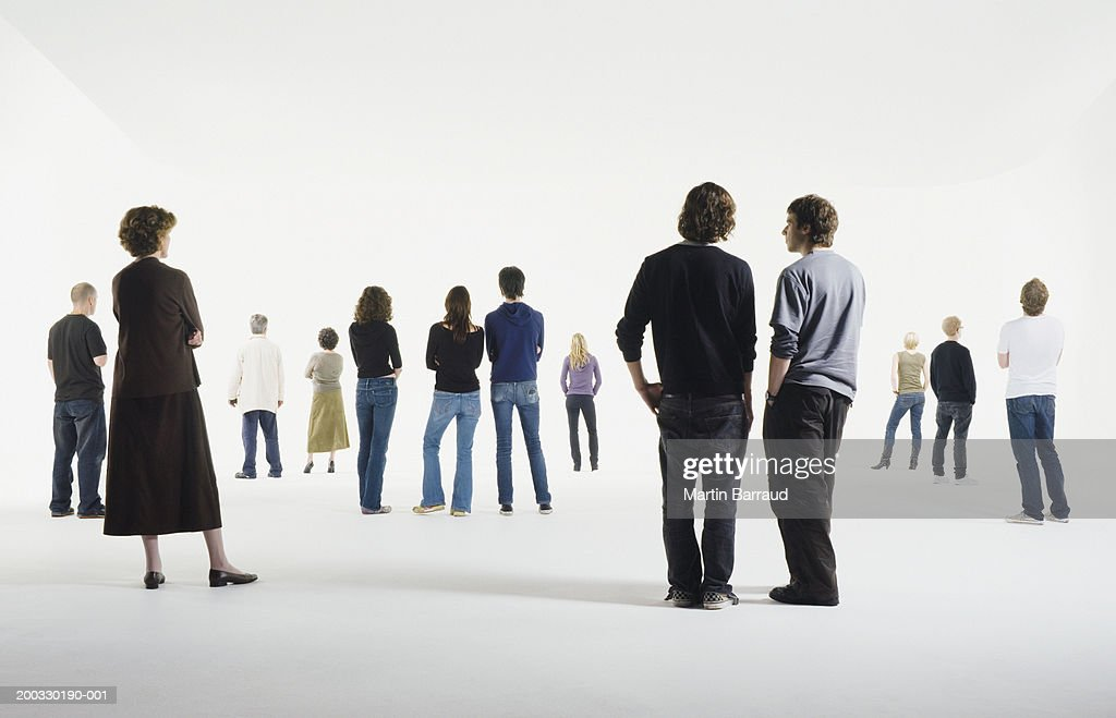 Group of people standing in studio, rear view : Stock Photo