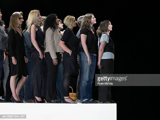 Group of people standing on catwalk