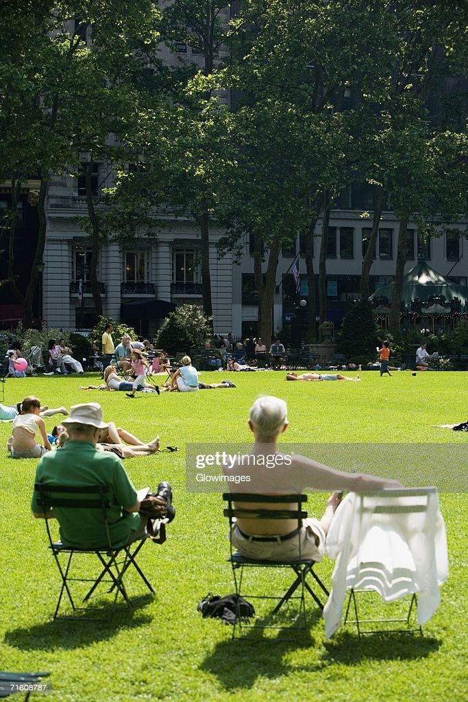 Group of people sunbathing in a park : Stock Photo