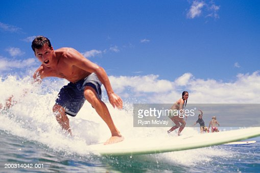 Group of people surfing in ocean : Stock Photo