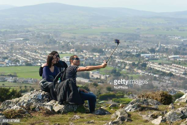 A group of people takes a selfy at the top of Bray Head On Sunday March 26 in Bray Ireland