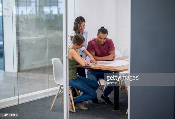 Group of people talking in a business meeting