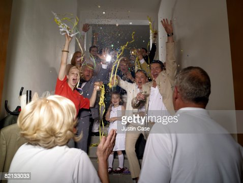Group of people throwing streamers : Stock Photo