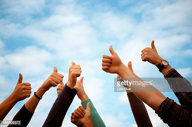 Group Of People Thumbs Up Blue Sky.Copy Space