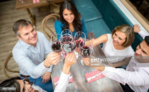 Group of people toasting at a restaurant