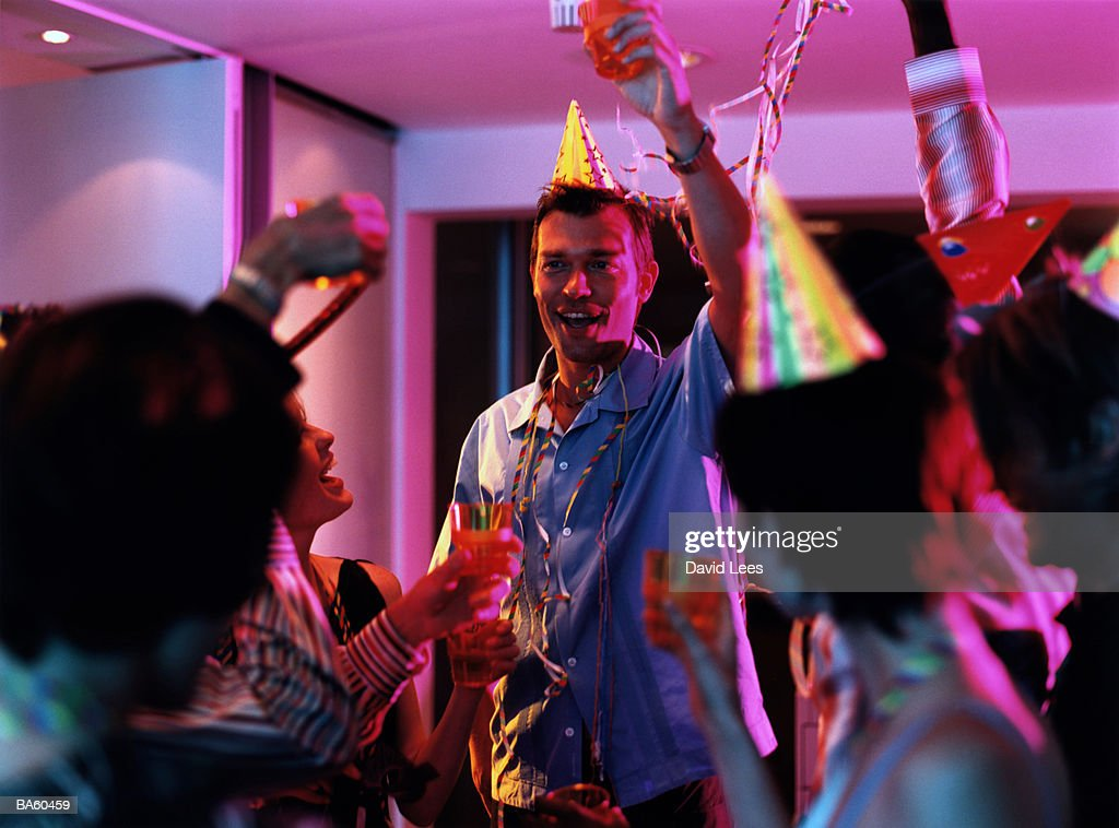 Group of people toasting at office party