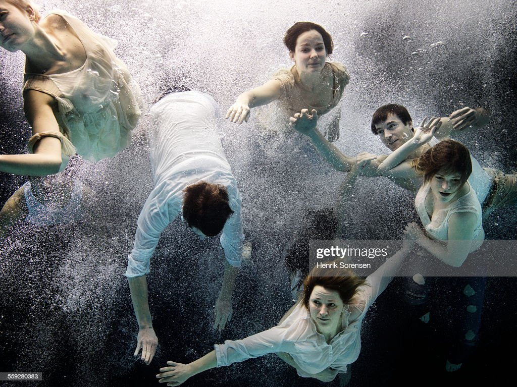 group of people under water
