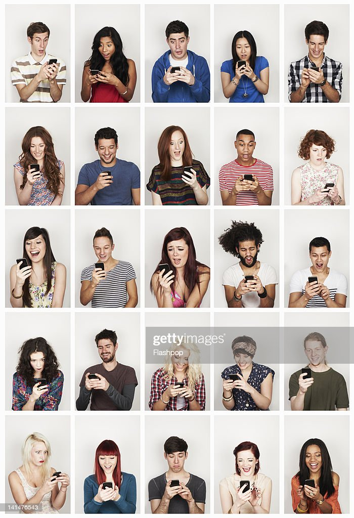 Group of people using a phone : Stock Photo
