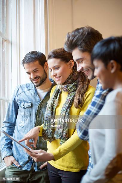 Group of people using digital tablet at startup