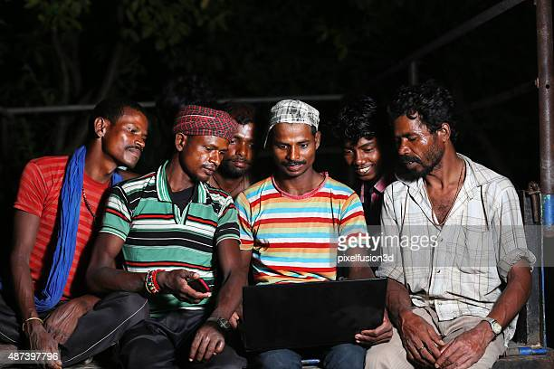 Group of people using laptop