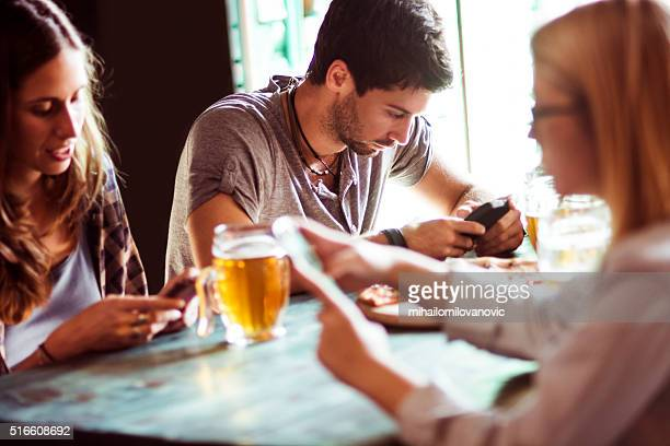 Group of people using smartphones