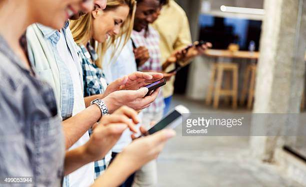 Group of people using their smart phones