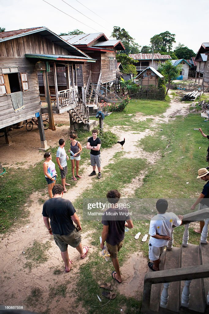 A group of people visit a local village : Stock Photo