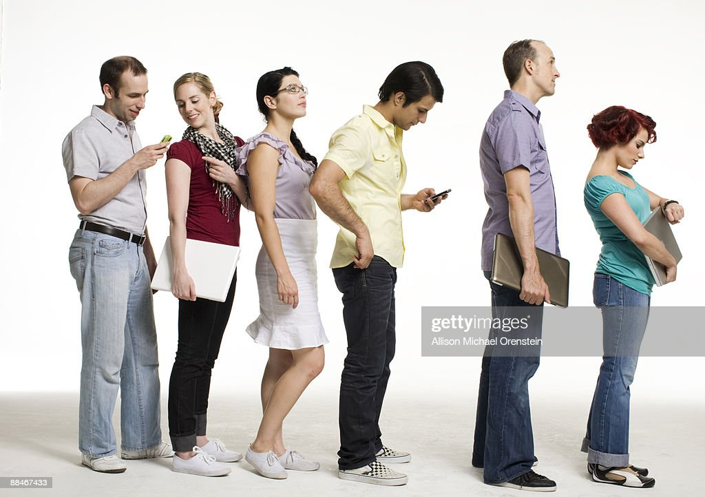 Group of people waiting in line